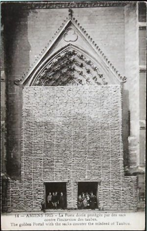 Amiens Cathedral. Southern transept door, the door of the golden Virgin, protected by sandbags, 1915