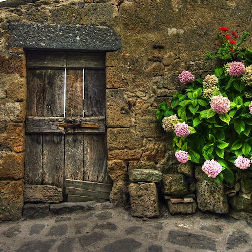 Old door in Pienza, province of Siena , Tuscany region Italy