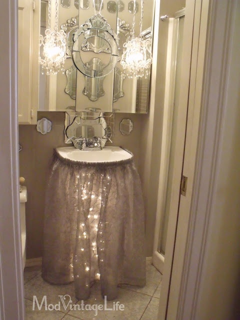 Love the sink skirt with lights underneath!  So pretty!  Mod Vintage Life: Glam Bathroom