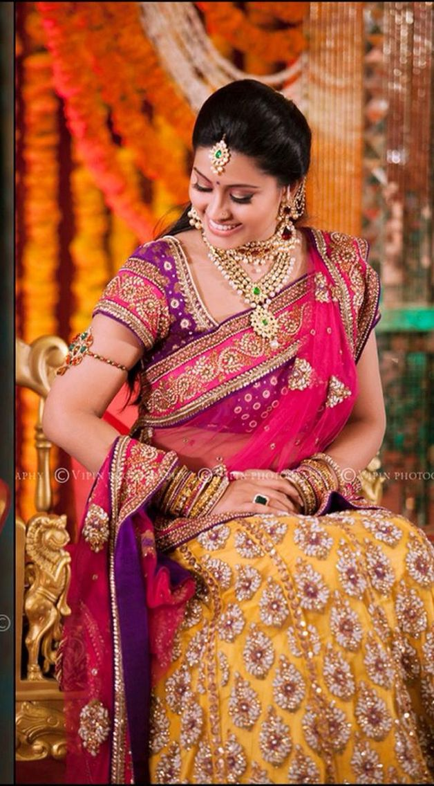 Golden yellow  + pink with heavy work lehenga and voilet blouse combination