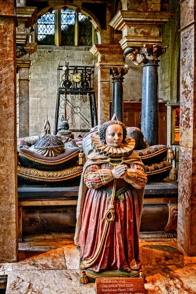 """""""Sir Lawrence, Chancellor of the Exchequer to James I who died in 1628, lies in state with his wife. He was reviled locally for his high-handed interference in local affairs, and had a reputation for greed and corrupt practices in office. For two centuries after his death, Burford residents gleefully burned an effigy of Lord Tanfield each year.   His wife commandeered St Catherine's Chapel for the memorial, after being refused permission for a tomb in Westminster Abbey. Their painted pra..."""