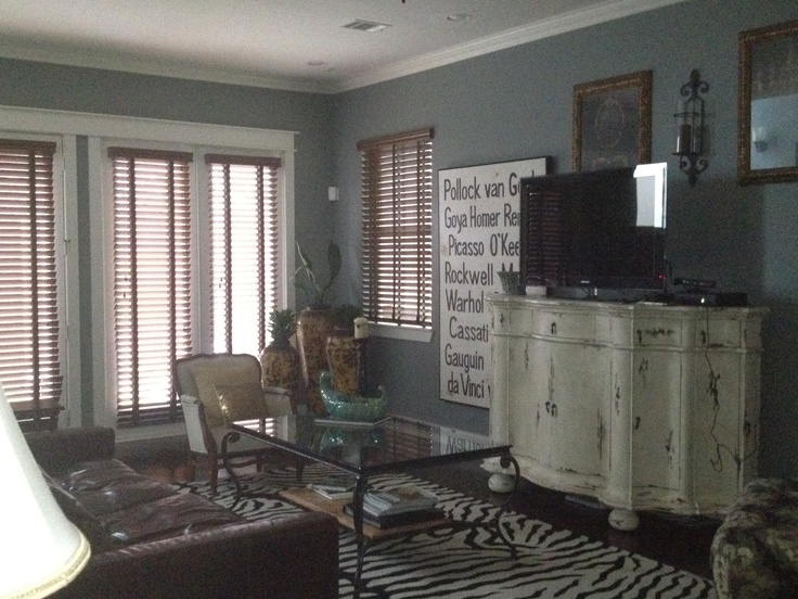 It S Tough To Tell But Opening Blinds Adds Texure Love Texture Shabby Console With Tv Mixed Art Work On The Wall Gray Walls Brown