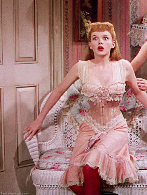 """Judy Garland in """"Meet Me In St. Louis"""" Scene the corset is too tight!...getting ready for the Christmas ball"""