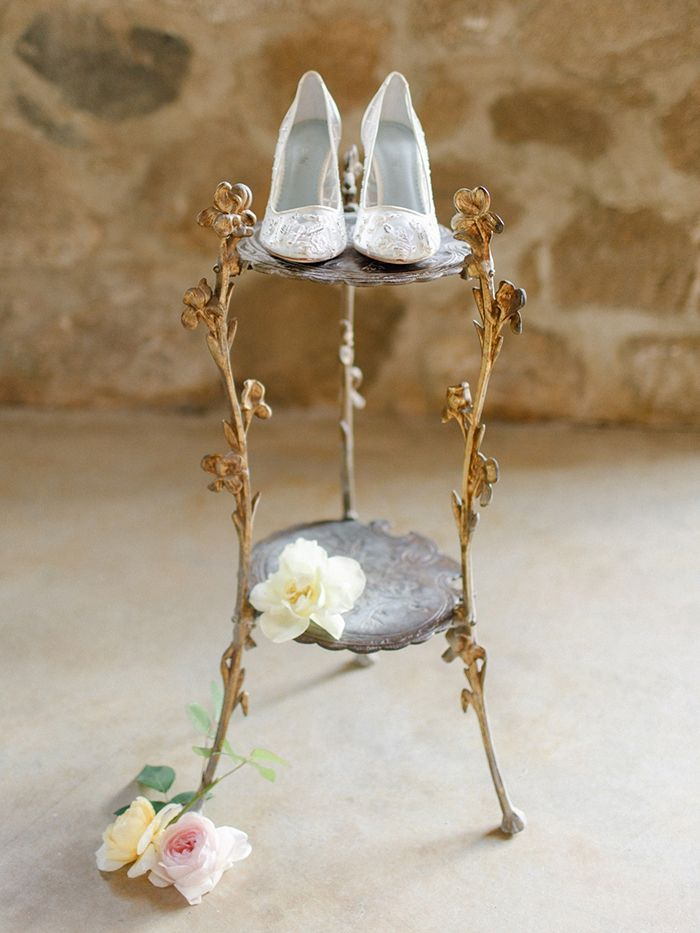 Romantic Lace Bridal Shoes on a Vintage Gold Stand