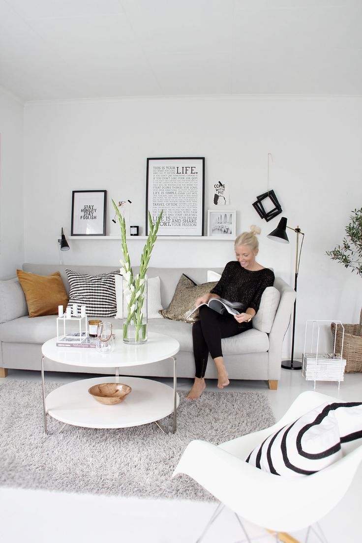 Living area idea. Pictures on wall, pillows, couch colour and style.