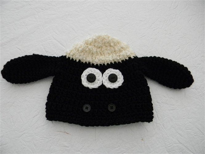 Have you heard of Shaun the sheep?? my kids love him!! I made this hat and its totally cute :)  www.proudchild.com