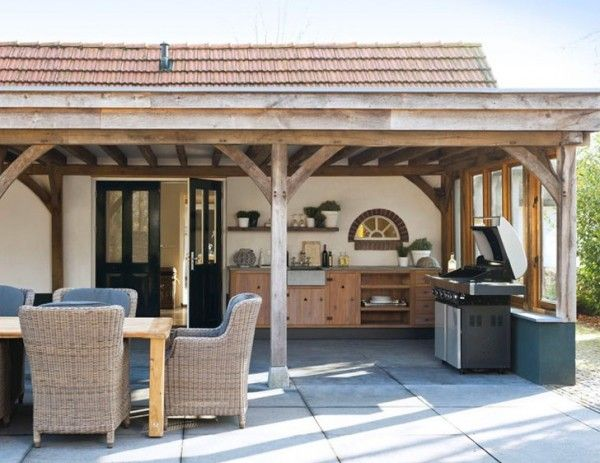 Outdoor summer kitchen design with long dining table