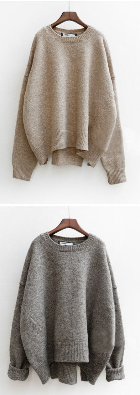 This knit sweater detailed with asymmetric hem and crewneck. It is cheaply offered at OASAP.com!