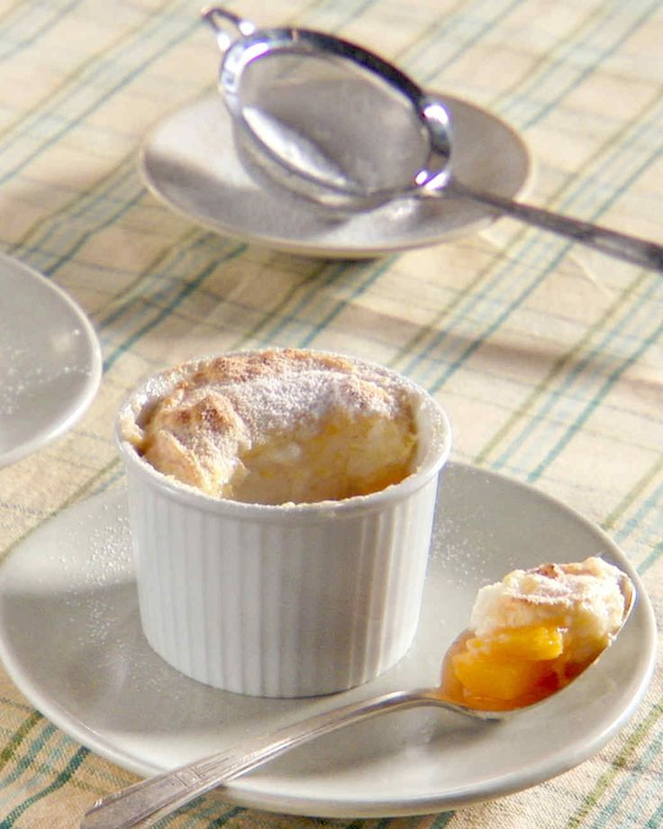 Ripe, juicy Georgia peaches line the bottom of souffle dishes and a peach meringue bakes into a light, airy topping in this recipe from Chef Virginia Willis.