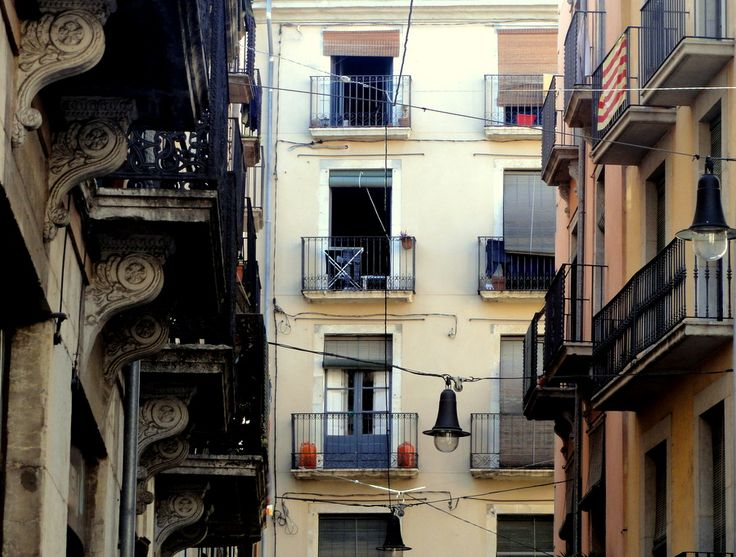 Columns, windows and grill balconies in Girona