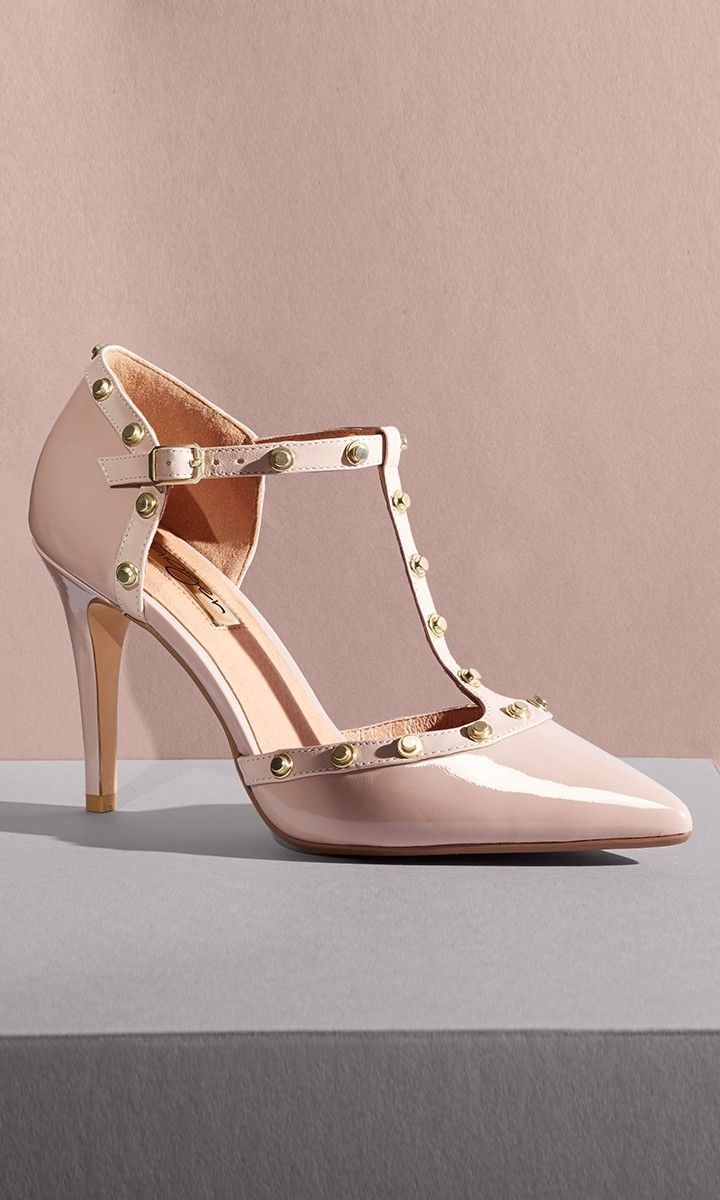 "Look like a million bucks without breaking the bank in these studded T-strap pumps styled in glossy patent leather—you know you""ll end up wearing them with everything! @Nordstrom"