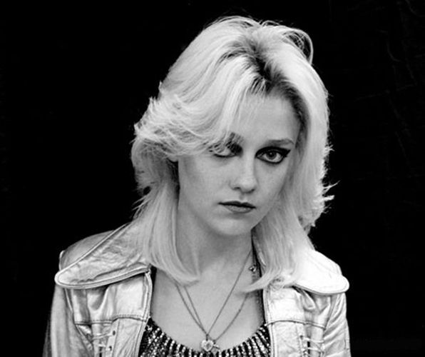 Dakota Fanning as Cherie Currie in The Runaways