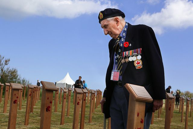 Canadian Veteran Joseph Cauch stands among newly mounted markers commemorating Canada's fallen at Juno Beach Centre, France. Veterans Affairs Minister, Julian Fantino, spoke today at the special ceremony leading up to tomorrow's 70th anniversary of D-Day.
