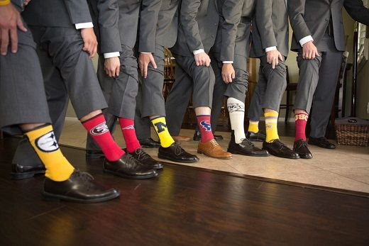 Groom with groomsmen wearing sports socks