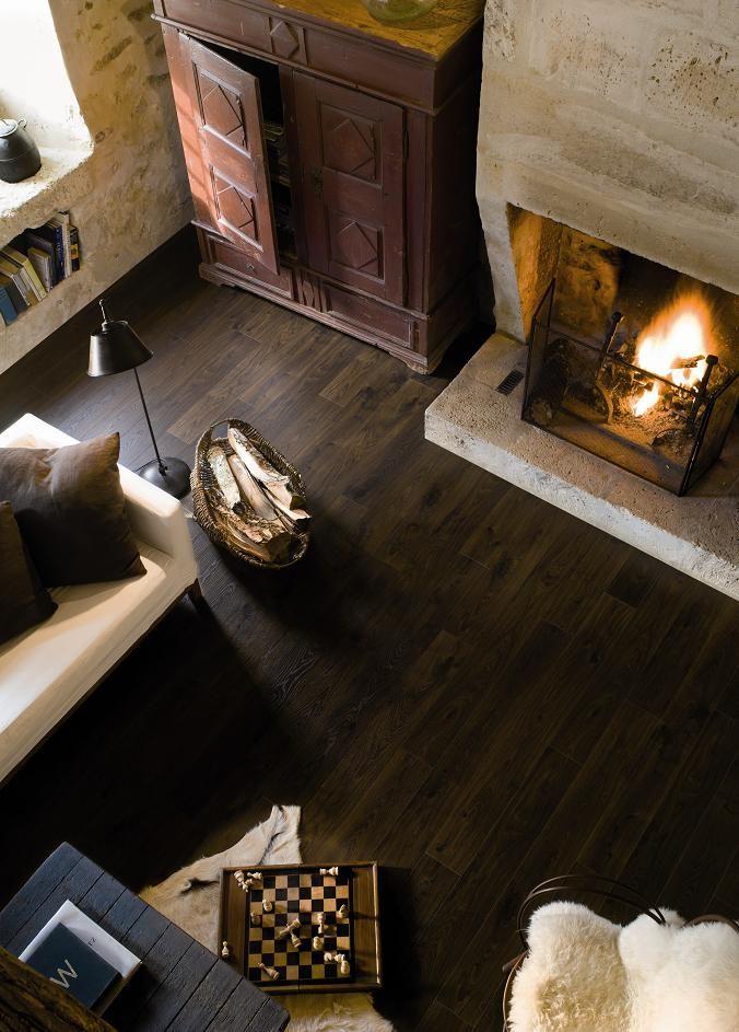 Warm interieur met haard en Quick-Step Laminaat Elite - vloeren ideeën | UW-vloer.nl #laminaat #vloer #laminaatvloeren