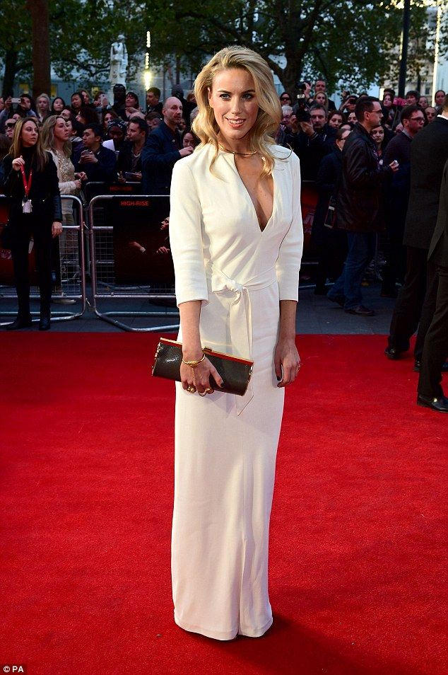 Glamorous:Alexandra Weaver wore a daring plunging ensemble to the premiere...