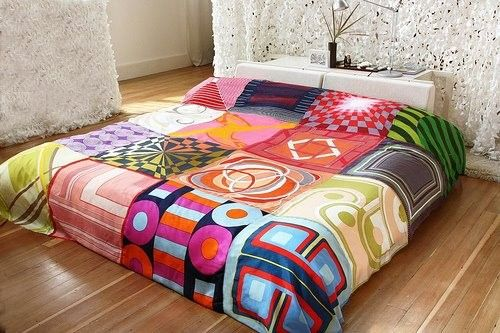 What's great about this bohemian-looking bed spread is that it's DIY, made from vintage silk scarves. #home #DIY #bedroom #decor #tribal #boho #eclectic.
