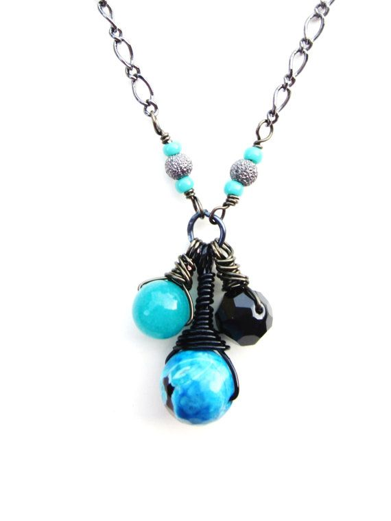 Teal Jade Black and Turquoise Fire Agate Black by LaJolieLolita Teal Jade, Black and Turquoise Fire Agate, Black Swarovski Crystal, and Genuine Truquoise Gemstone Beaded, Wire Wrap Pendant Necklace