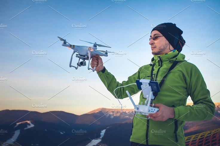 Man operating a drone by Volodymyr.Goinyk on @creativemarket