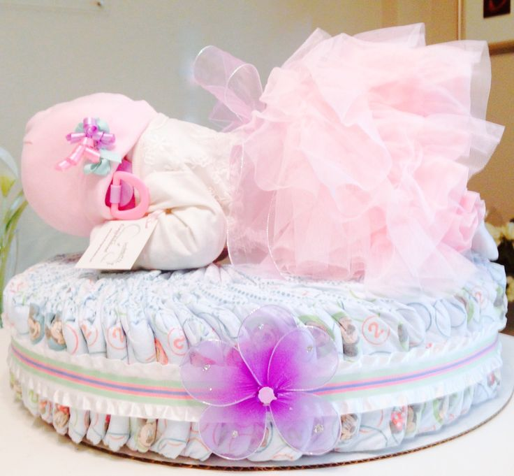 Custom Pretty in PINK! Diaper Baby Cake! Perfect for a baby shower gift, a baby shower centerpiece, a hospital gift or nursery decor.  Want to customize or personalize your gift? Ask us how!  Now offering hospital delivery! www.everythingandthebaby.com