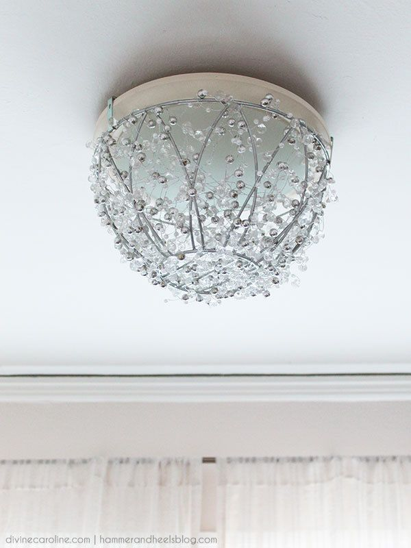 If you're in an apartment or starter home, chances are you don't have a lot of say in the type of fixtures you have. Check out this DIY chandelier tutorial to update your space and make it your own. #diy #chandelier