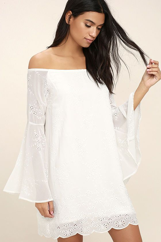 Elevate your look to star status with the Sway My Way White Embroidered Off-the-Shoulder Dress! Slightly sheer Georgette is adorned in pierced floral embroidery, forming an off-the-shoulder neckline (with no-slips strips), and long bell sleeves. Darted shift bodice has a mini skirt with scalloped hem. Hidden back zipper/clasp.