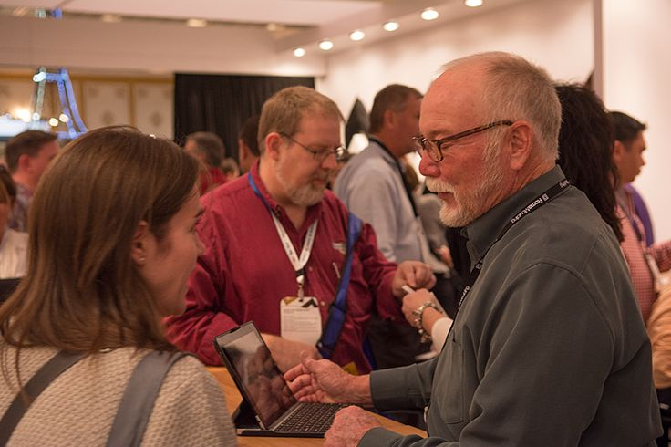 Bob chatting it up with a partner at the #WCAF15 #ChoosePowerfully