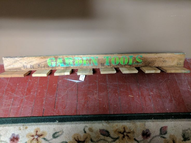 Yard tool rack made from pallet scraps.