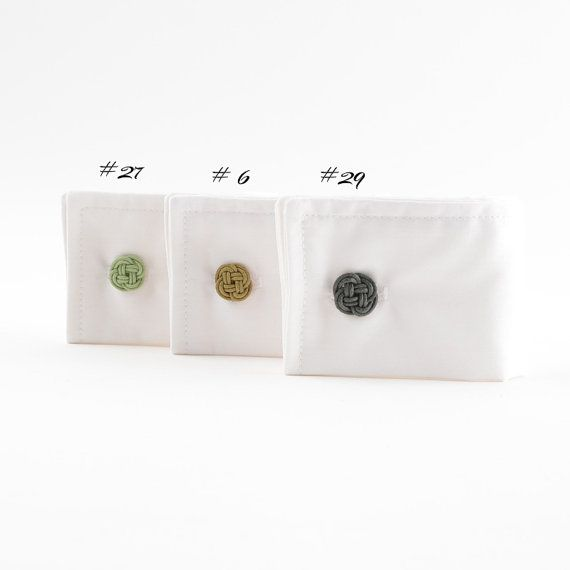 Unique designed and perfectly finished clover flower cuff links. Made of cotton twine with metal cuff link bases. Available in 3 shades and 2 sizes.   Limited edition order before they are gone.