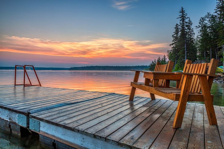 Clear Lake Sunrise - Empty chairs on one of the docks near the old campground in Clear Lake, Riding Mountain National Park, Manitoba Canada
