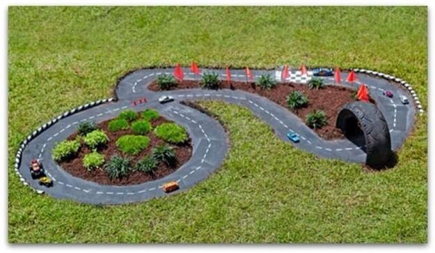 Track for toy cars built into garden