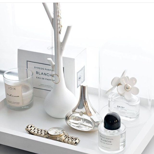 home office desk inspiration. white tray with candles and perfume.