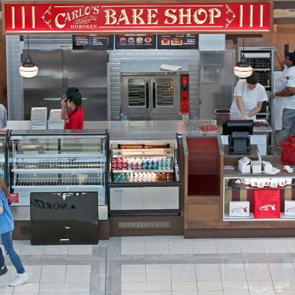 Carlo's Bakery, the retail shop from the family behind TLC show Cake Boss, now has 14 locations. And yet: The opening of the Carlo's Bakery in...