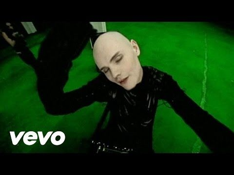 """Official video for Smashing Pumpkins song """"Ava Adore"""" from the album Adore. Buy It Here: http://smarturl.it/3zqdrv Directed by Dom and Nic, the music video f..."""