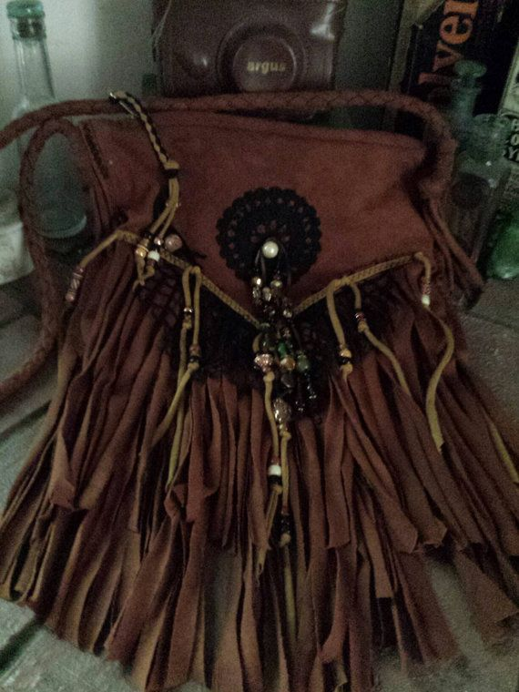 Check out this item in my Etsy shop https://www.etsy.com/listing/459701756/rawhide-n-lace-fringe-festival-bag