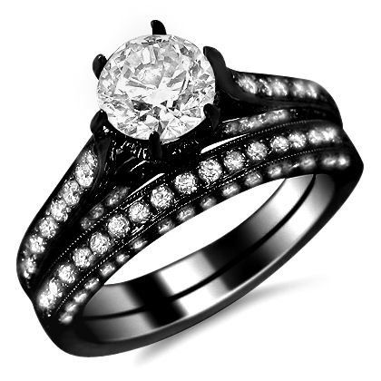14k Black Gold Six Prong Engagement Ring Bridal Set - This is a gorgeous 2.10 carat Six Prong Engagement Ring Bridal Set stamped in 14k Black Gold. It features a lovely .65 carat SI1 clarity & F color large White Round Brilliant Cut Diamond is set atop of the ring. It's also surrounded by .65 carats & .80 carats of white diamonds on the matching band. They are pave set on each side of the ring & on its outsides. The set measures 7.5mm wide & the diamonds are 100% natural…