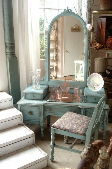 I have an vintage vanity dresser nearly identical to this that I found at a yard sale years ago.  I love it. I painted mine white years ago but I absolutely love this seafoam color.  I've seen these at antique stores but usually in the original wood finish.