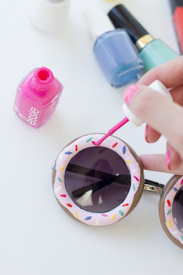 DIY Donut Sunglasses. You Need: Round Sunglasses with a Wide Rim, Nail Polish in Various Donut + Sprinkle Colors, Toothpicks. Paint the entire rim of your sunglasses with your donut color. Do two coats. Use your frosting color to paint on some frosting! Again, two coats might be necessary depending on your polish and color. Let dry. Carefully paint on some sprinkles. Dip a toothpick in the polish and use that to make the sprinkles. Let dry.