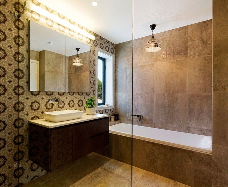 Morrocan inspired bathroom and featured lighting. Who would not love to jump for a bath!