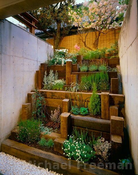 no instructions but good inspiration for taking a very narrow and challenging space and turning it into a tiered garden with vertical - Garden Design Using Sleepers