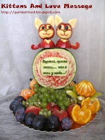 fruit carving arrangement with watermelon and apple sculpture of cats