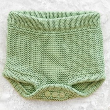 Dont need buttons, since it is only panty sized you pull it off to change diaper. Ridiculous amount of work for a diaper cover.
