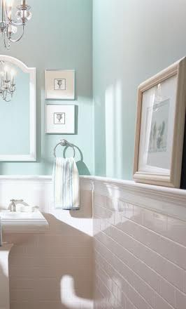Lovely Robin's egg blue bathroom -- love the shelf along the tile top and the glamorous accessories.