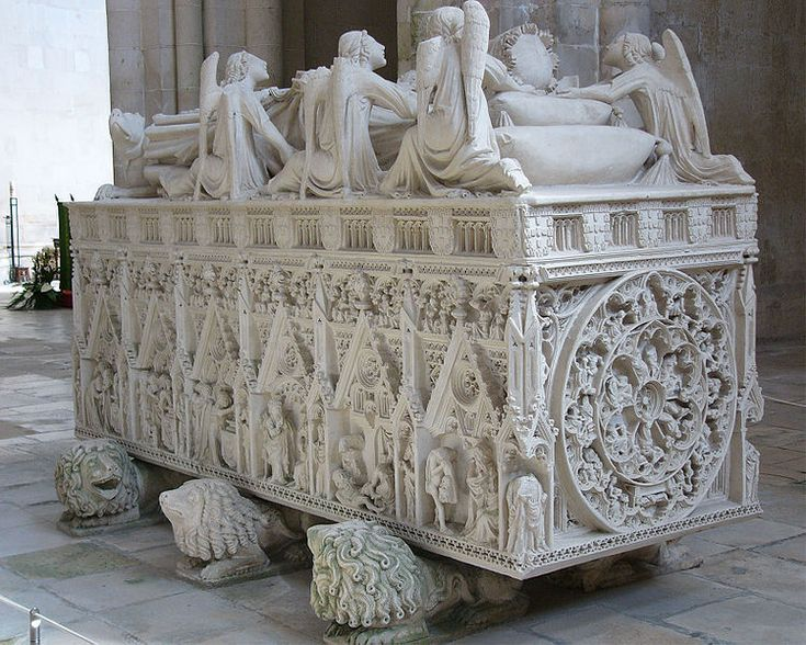 The ornate medieval tomb of King Pedro I of Portugal , assassinated, in 1355, under the orders of his father, King Afonso IV, in the Alcobaca Monastery