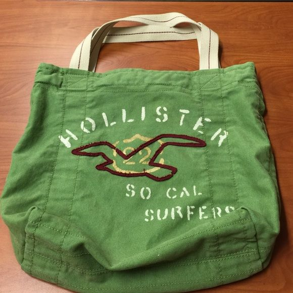 Hollister tote bag Hollister green tote. Sturdy enough for textbooks; cute enough to be a purse. Great for the beach, overnight bag, etc. Hollister Bags Totes