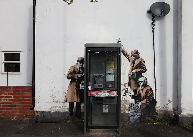 "Banksy, ""Surveillance in Cheltenham"" made in the year 2014. I think there was over nine stencils used. Because of the different colours used."