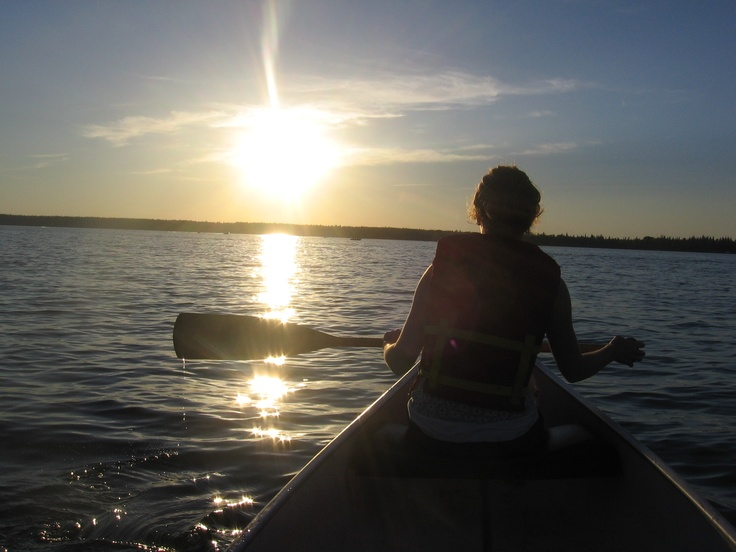 Canoeing into the sunset on Kimball Lake at Meadow Lake Provincial Park in SK.