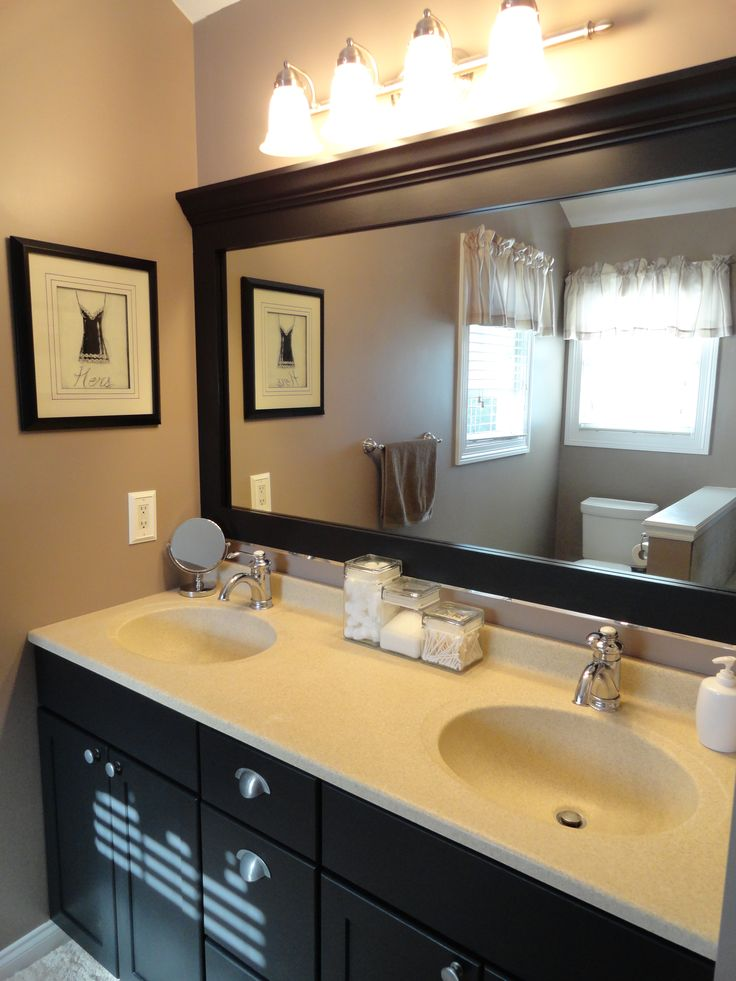 easy way to update bathroom - paint vanity and frame mirror...love this!