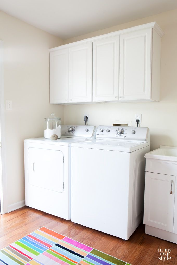 Why didn't I install wall cabinets to my mudroom sooner?  It was so easy.  Love the way my laundry room looks now with closed storage. How to install wall cabinets  in a laundry room or any room.