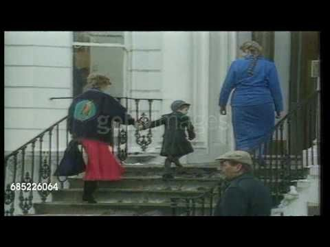 January 15, 1987: Princess Diana taking Prince William to school at the Wetherby School in London for the first time as he turns to wave to press. (TX 15.1.87/ITN Video).